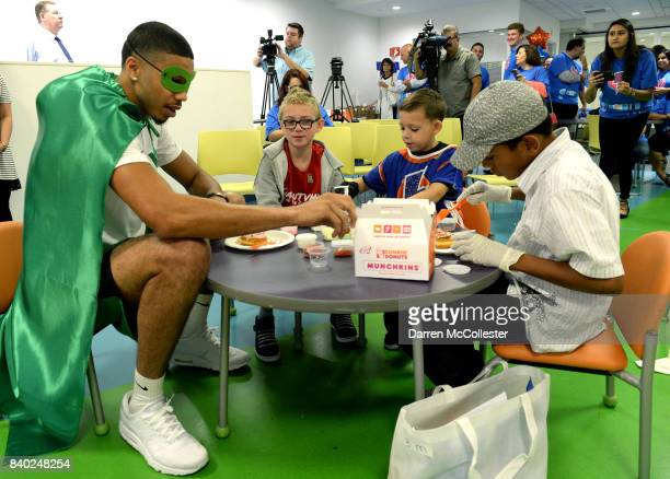 Boston Celtic Jayson Tatum decorates donuts with the kids during Day of Joy Celebration at Boston Children's Hospital August 28 2017 in Boston...