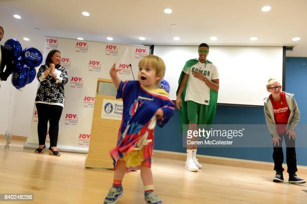 Boston Celtic Jayson Tatum Matthias and Evelyn show of their superhero poses during Day of Joy Celebration at Boston Children's Hospital August 28...