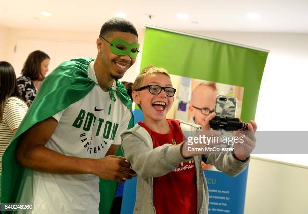 Boston Celtic Jayson Tatum takes a selfie with Matthias at Boston Children's Hospital August 28 2017 in Boston Massachusetts