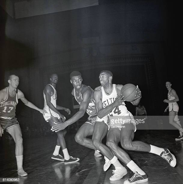 Boston Celtic Sam Jones drives towards the basket defended by Cincinnati Royal Oscar Robertson in the fourth quarter of the basketball game The...