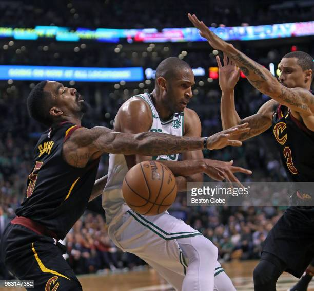 Boston Celtics' Al Horford battles with Cleveland Cavaliers' JR Smith and George Hill first half action The Boston Celtics hosted the Cleveland...