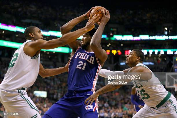 Boston Celtics' Al Horford left and Marcus Smart guard 76ers' Joel Embiid in the second quarter The Boston Celtics host the Philadelphia 76ers in a...