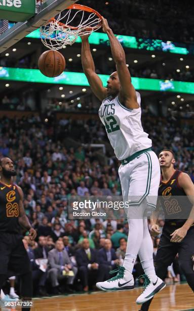Boston Celtics Al Horford slams home two points as the Cavaliers LeBron James and Larry Nance Jr watch in the first half The Boston Celtics hosted...