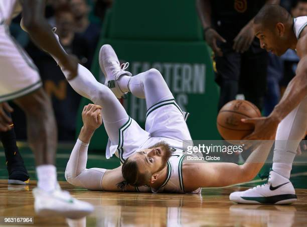 Boston Celtics Aron Baynes got off a pass to teammate Al Horford with his back on the floor in the second half The Boston Celtics hosted the...