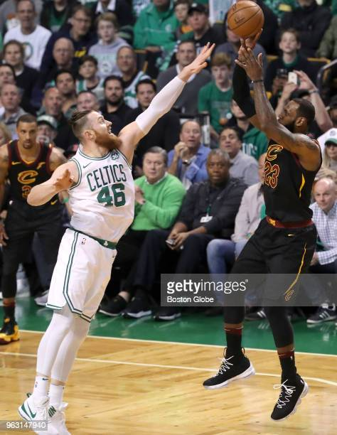 Boston Celtics Aron Baynes plays defense on Cleveland Cavaliers LeBron James during the first quarter The Boston Celtics hosted the Cleveland...