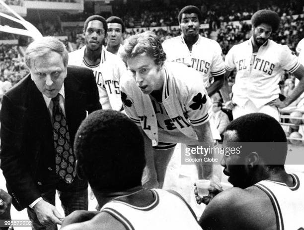 Boston Celtics assistant coach Robert MacKinnon left and head coach Dave Cowens hold a timeout The Boston Celtics host the Denver Nuggets in a...