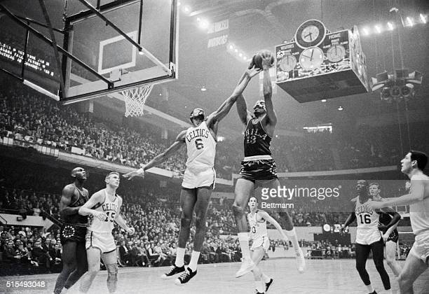 Boston: Celtics' Bill Russell harasses 76ers' Wilt Chamberlain as he attempts to score, 2nd quarter action, Boston Garden. Celtics' John Havlicek .