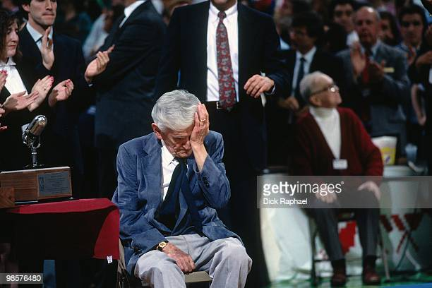 Boston Celtics broadcaster Johnny Most sheds a tear as he is honorored during a game played in 1991 at the Boston Garden in Boston Massachusetts NOTE...