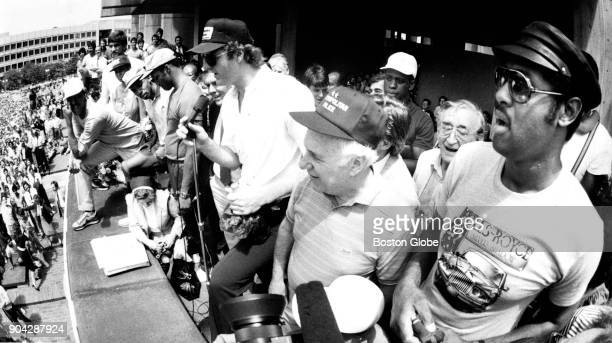 Boston Celtics captain Larry Bird center addresses the crowd with teammates and Red Auerbach during a celebration of the Celtics' championship win at...