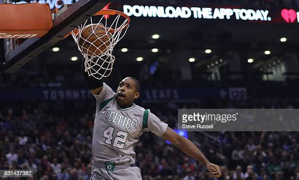TORONTO ON JANUARY 10 Boston Celtics center Al Horford dunks as the Toronto Raptors wearing their throw back Toronto Huskies uniforms beat the Boston...