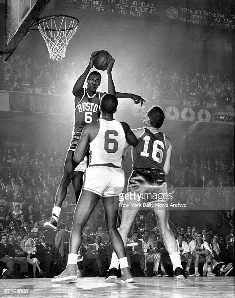 Boston Celtics center Bill Russell [#6] grabs rebound in game against the N.Y. Knicks at Madison Square Garden.
