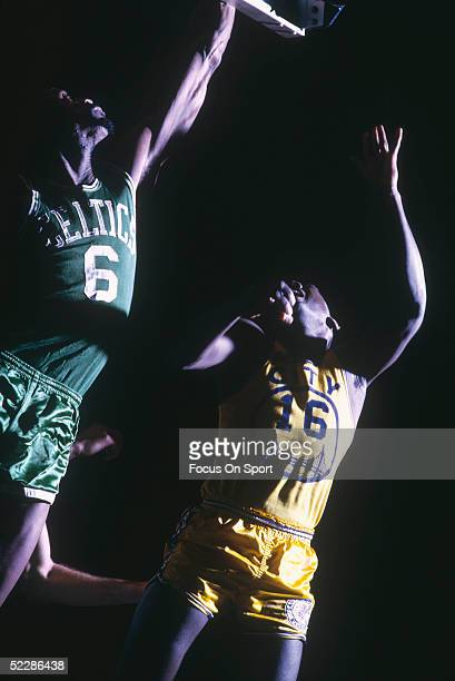 Boston Celtics' center Bill Russell goes to the basket during a game in 1965 at the Boston Garden in Boston Massachusetts