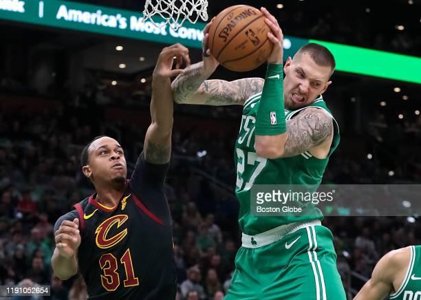 Boston Celtics center Daniel Theis rebounds over Cleveland Cavaliers player John Henson during the second quarter. The Boston Celtics host the...