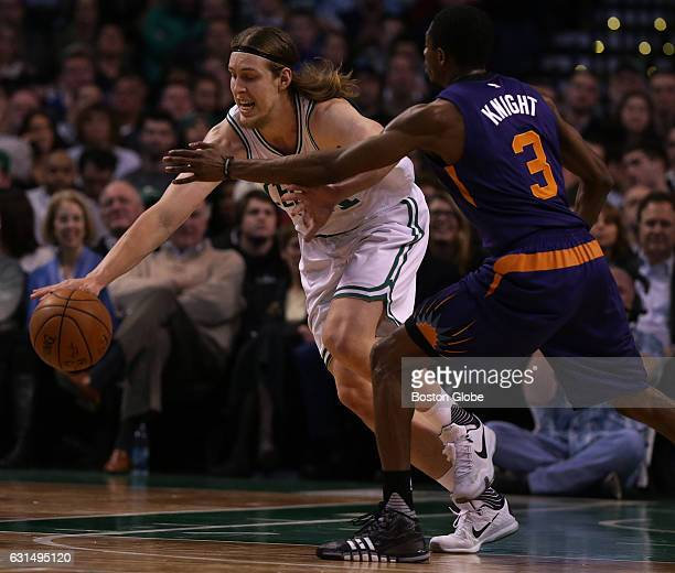 Boston Celtics center Kelly Olynyk steals the ball from Phoenix Suns guard Brandon Knight in the first half The Boston Celtics take on the Phoenix...