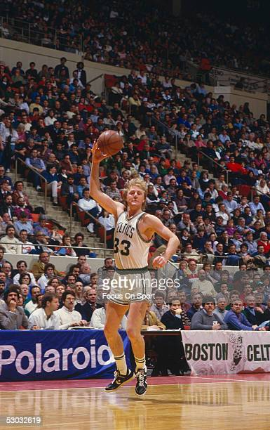 Boston Celtics' center Larry Bird passes to a teammate during a game at Boston Garden circa 1990 in Boston Massachusetts NOTE TO USER User expressly...