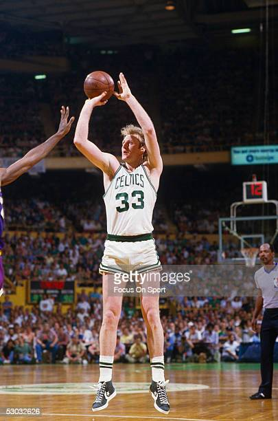 Boston Celtics' center Larry Bird shoots a jumpshot during a game at Boston Garden circa 1990 in Boston Massachusetts NOTE TO USER User expressly...