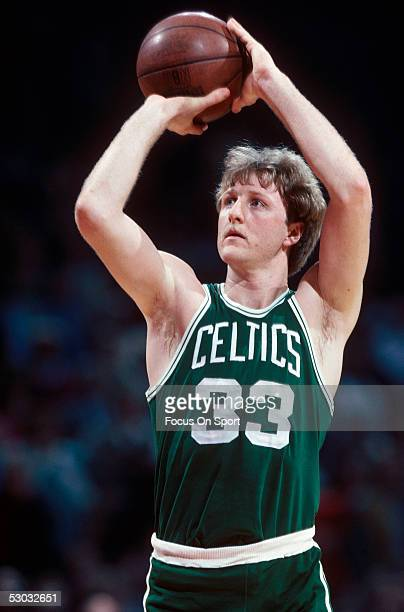 Boston Celtics' center Larry Bird shoots from the foul line during a game. NOTE TO USER: User expressly acknowledges and agrees that, by downloading...