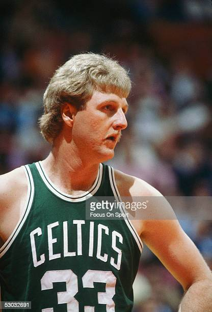 Boston Celtics' center Larry Bird stands on the court during a game. NOTE TO USER: User expressly acknowledges and agrees that, by downloading and/or...