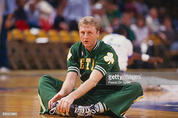 Boston Celtics' center Larry Bird stretches before a game NOTE TO USER User expressly acknowledges and agrees that by downloading and/or using this...