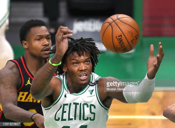 Boston Celtics center Robert Williams III grabs a round in the fourth quarter under the Celtics basket as Atlanta Hawks guard Brandon Goodwin , left,...