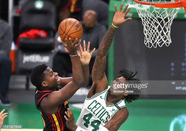 Boston Celtics center Robert Williams III , right, tries to block the second quarter shot of Atlanta Hawks center Clint Capela . The Boston Celtics...