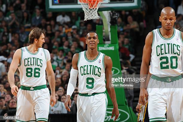 Boston Celtics center Semih Erden Boston Celtics point guard Rajon Rondo and Boston Celtics shooting guard Ray Allen walk on court during the game...