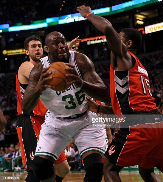 Boston Celtics center Shaquille O'Neal goes up with a shot as Toronto Raptors power forward Amir Johnson defends in the first half Boston Celtics vs...