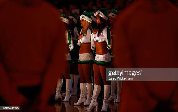 Boston Celtics cheerleaders listen to the national anthem prior to the game between the Boston Celtics and the Cleveland Cavaliers on December 19...