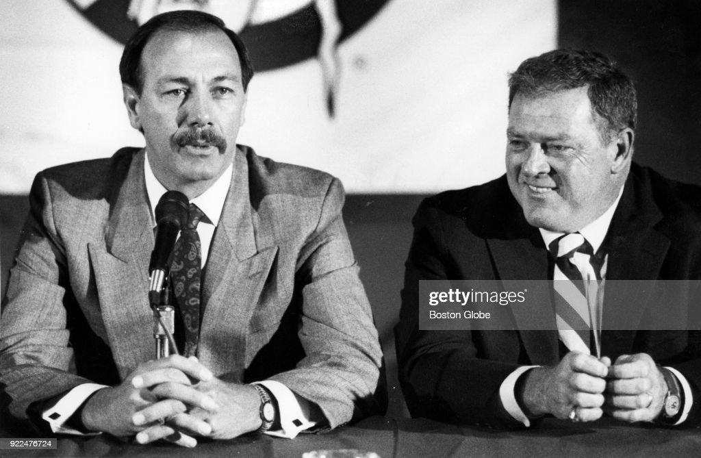 Boston Celtics coach Chris Ford, left, and Dave Gavitt, right, speak during a press conference in Boston, June 12, 1990.