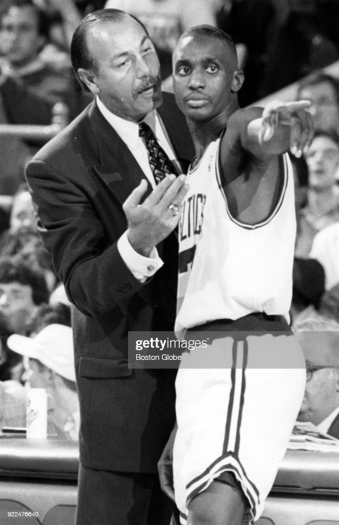 Boston Celtics coach Chris Ford, left, speaks with Dee Brown, right, during a game against the New York Knicks at the Boston Garden, Nov. 5, 1993.