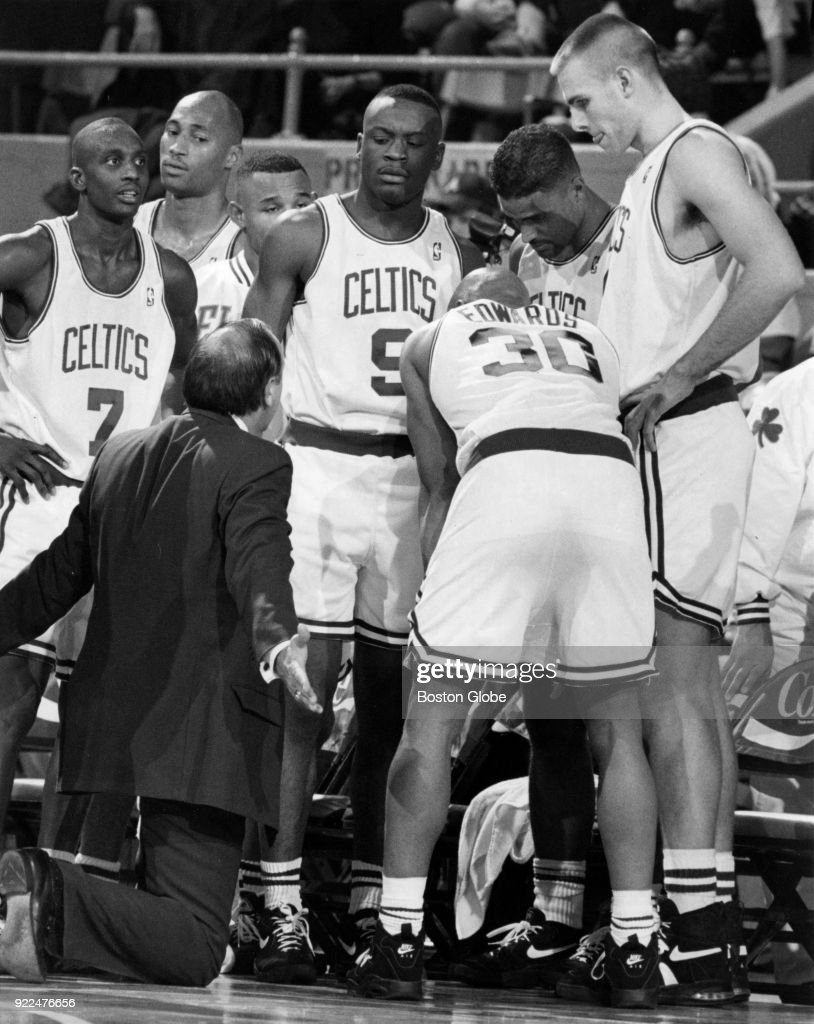 Boston Celtics coach Chris Ford pleads his case as his players listen during a timeout of a game against the Cleveland Cavaliers at the Boston Garden, Dec. 9, 1994.