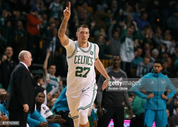 Boston Celtics' Daniel Theis reacts after making a threepoint basket against the Charlotte Hornets during the fourth quarter The Boston Celtics host...
