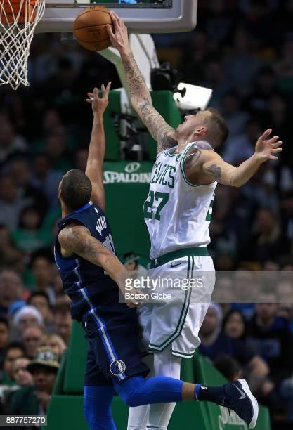 Boston Celtics' Daniel Theis right blocks a first half shot attempt by the Mavericks' Devin Harris left The Boston Celtics host the Dallas Mavericks...