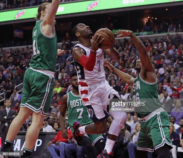Boston Celtics defense doubles down on Washington Wizards guard John Wall during the first quarter The Washington Wizards host the Boston Celtics in...
