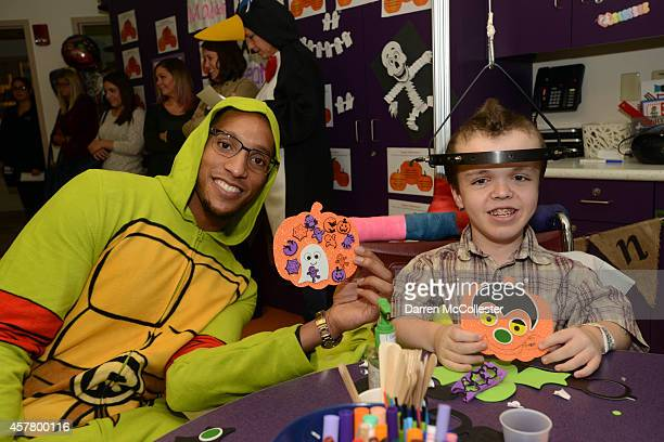 Boston Celtics Evan Turner spends time Alex with at Boston Children's Hospital October 24 2014 in Boston Massachusetts