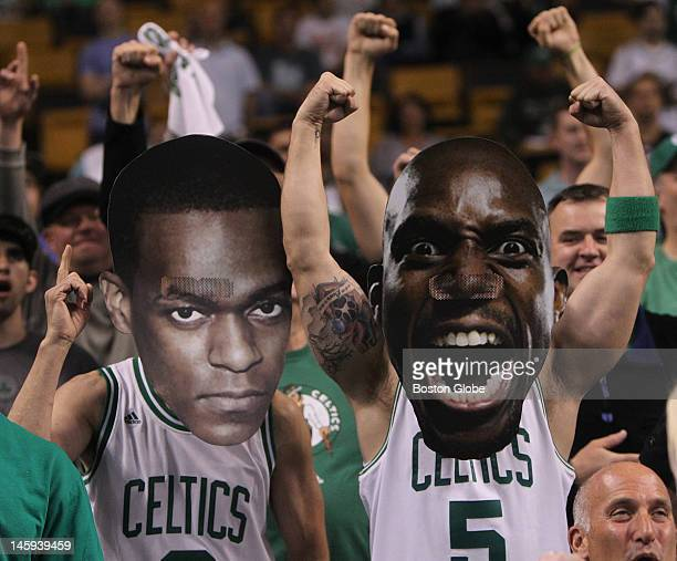 Boston Celtics fans cheer before the start of the game. Boston Celtics NBA basketball, action and reaction. The Celtics play the Miami Heat in game...