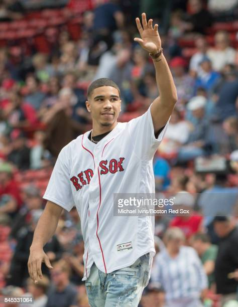 Boston Celtics first round draft pick Jason Tatum waves to the crowd before throwing out a ceremonial first pitch at a game between the Boston Red...