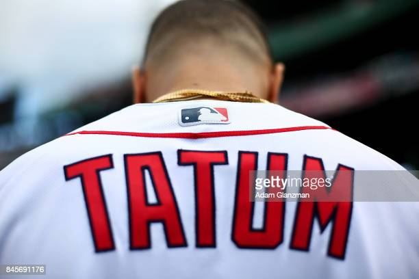Boston Celtics first round draft pick Jayson Tatum looks on before throwing out the ceremonial first pitch before a game between the Boston Red Sox...