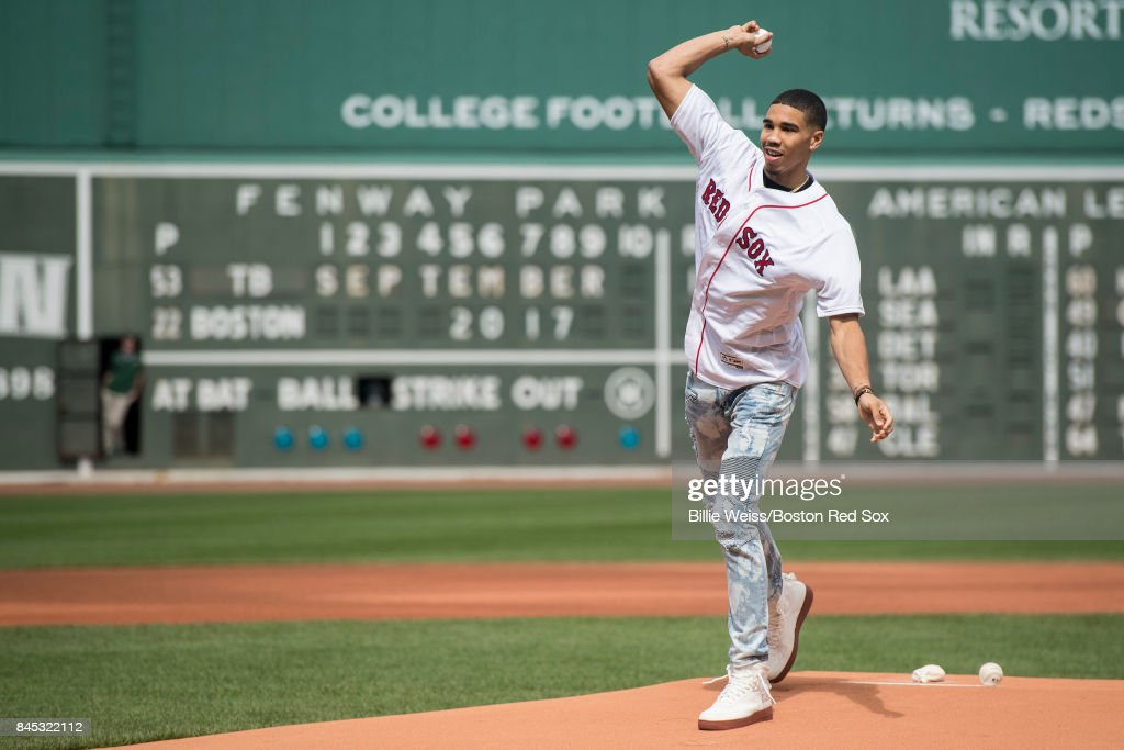 Boston Celtics first round draft pick Jayson Tatum throws out the ceremonial first pitch before a game between the Boston Red Sox and the Tampa Bay Rays on September 10, 2017 at Fenway Park in Boston, Massachusetts.