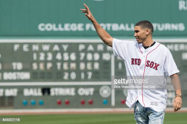 Boston Celtics first round draft pick Jayson Tatum waves after throwing out the ceremonial first pitch before a game between the Boston Red Sox and...