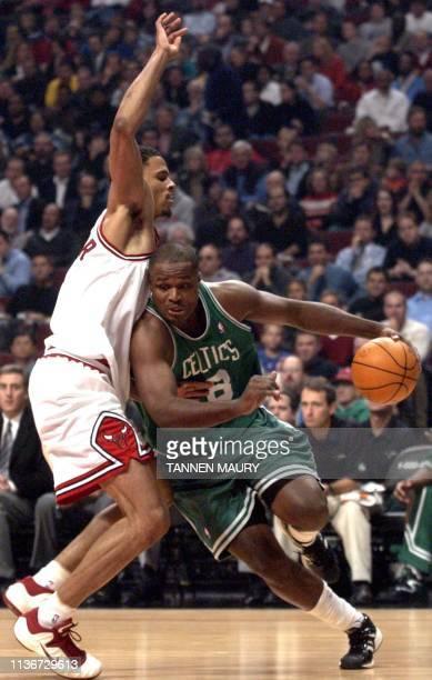 Boston Celtics forward Antoine Walker works his way around Chicago Bulls forward Tyson Chandler in the first half of their NBA matchup 06 November...