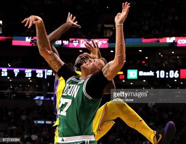Boston Celtics forward Daniel Theis and Los Angeles Lakers forward Julius Randle battle for a rebound during the fourth quarter The Boston Celtics...