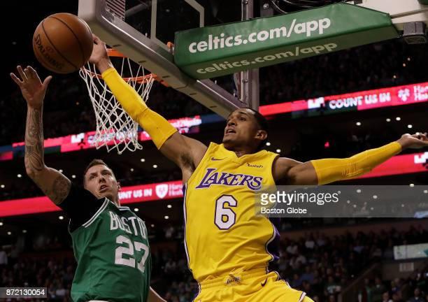 Boston Celtics forward Daniel Theis knocks the ball away from Los Angeles Lakers guard Jordan Clarkson during the fourth quarter The Boston Celtics...
