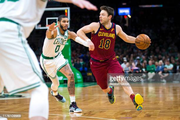 Boston Celtics forward Jayson Tatum covers Cleveland Cavaliers guard Matthew Dellavedova during the first quarter. The Boston Celtics host the...