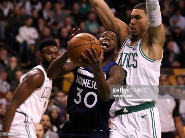 Boston Celtics forward Jayson Tatum defends Minnesota Timberwolves guard Aaron Brooks during the third quarter The Boston Celtics host the Minnesota...