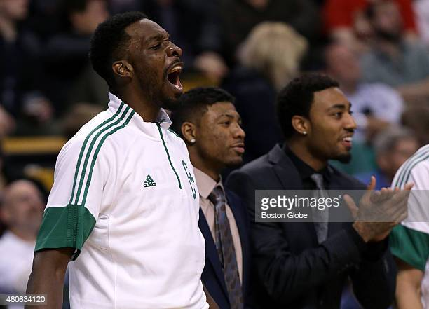 Boston Celtics forward Jeff Green let out a howl of delight after a driving dunk by Boston Celtics center Kelly Olynyk not pictured also sent Olynyk...