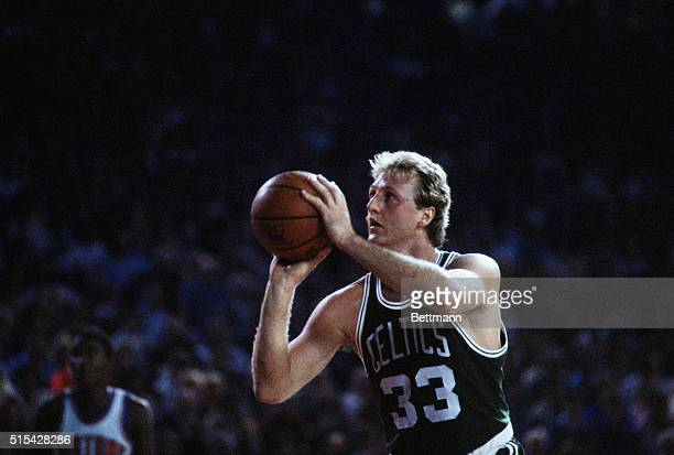 Boston Celtics forward Larry Bird shoots a free throw during a game against the Detroit Pistons at the Pontiac Silverdome in Pontiac Michigan