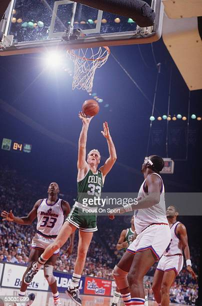 Boston Celtics' forward Larry Bird shoots against the Washington Bullets during a game at Capital Centre circa 1982 in Washington DC NOTE TO USER...