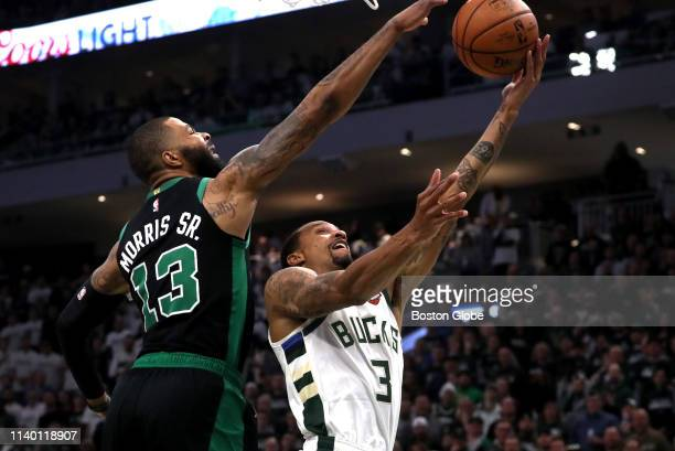 Boston Celtics forward Marcus Morris blocks a layup attempt by Milwaukee Bucks guard George Hill during the second quarter The Milwaukee Bucks host...