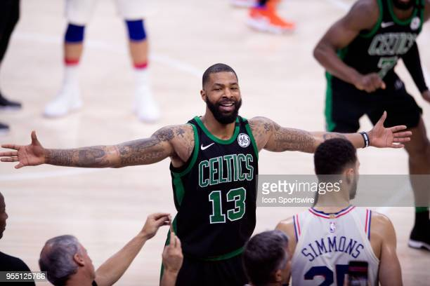 Boston Celtics Forward Marcus Morris smiles as he guards Philadelphia 76ers Guard Ben Simmons on an inbound pass while leading with only a few...